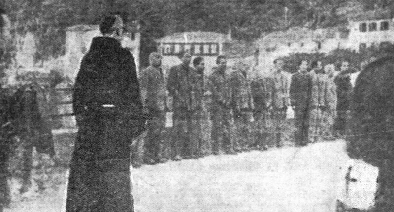 Father Accursio Ferrari of the franciscan sanctuary gives absolution to the Senior Fascists, lined up on the lakeside before the shooting. 28.4.1945